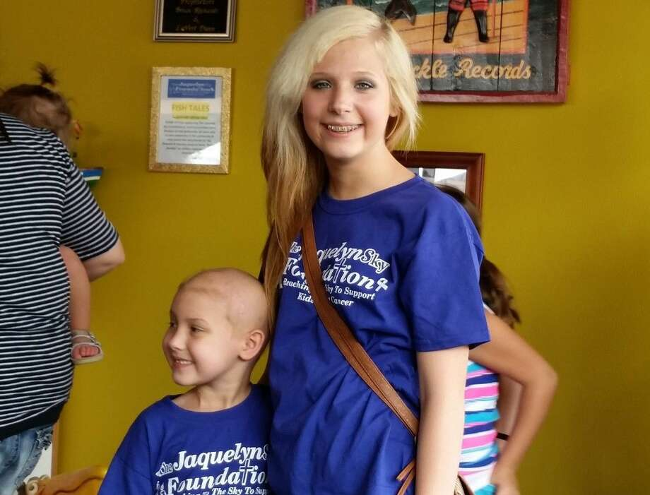 Robin Havard, left, stands with sister, Haley Welch.