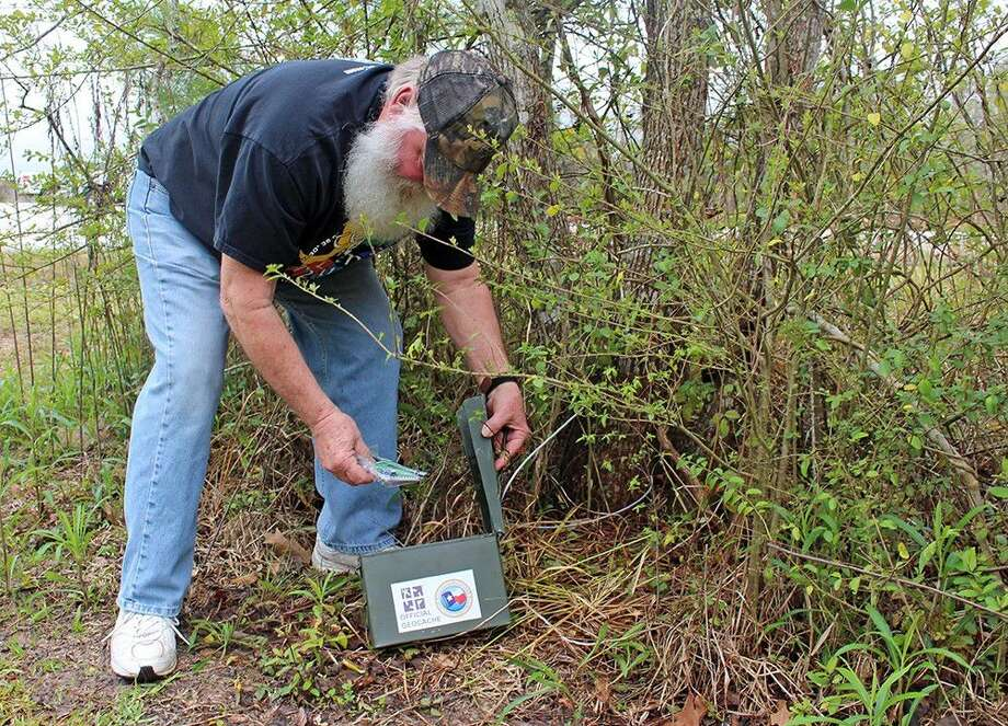 A geocacher completes the 2015 GeoChallenge at Dennis Johnston Park. Photo: Submitted Photo
