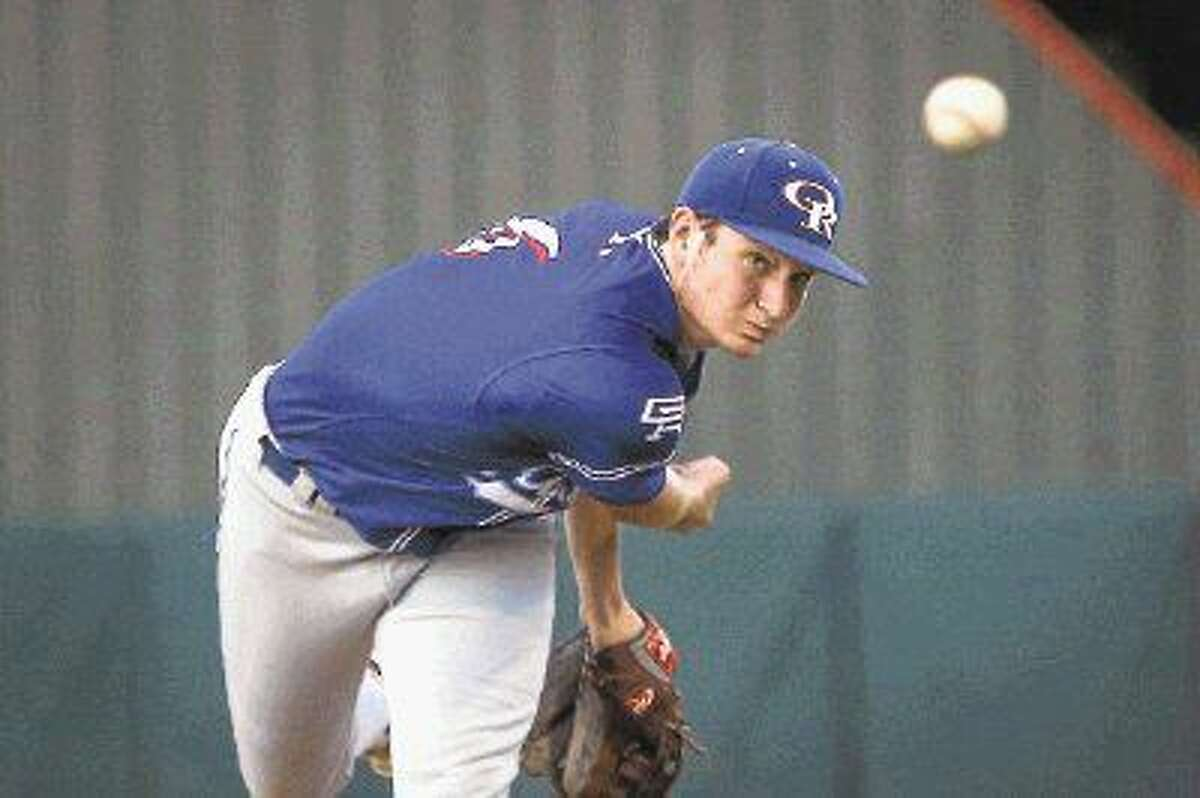 Oak Ridge's Tyler Davis (6) throws a pitch during the high school baseball game against The Woodlands back in April.