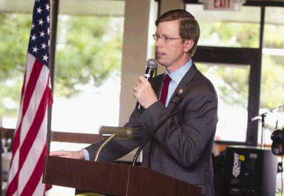 State Rep. Will Metcalf talks about recent legislation during the Lake Conroe Area Republican Women's meeting Thursday. Photo: Jason Fochtman