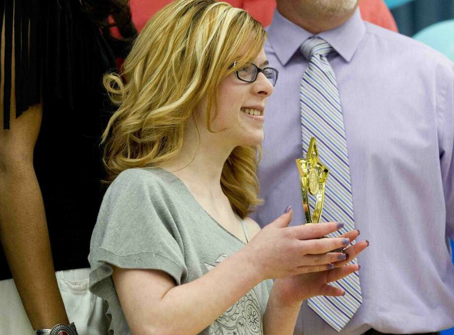Caney Creek's Jacie Cotton is recognized as an outgoing member of the Conroe Stars during the organization's Special Olympics banquet Tuesday at Wilkinson Elementary. Go to HCNpics.com to purchase this photo and others like it.