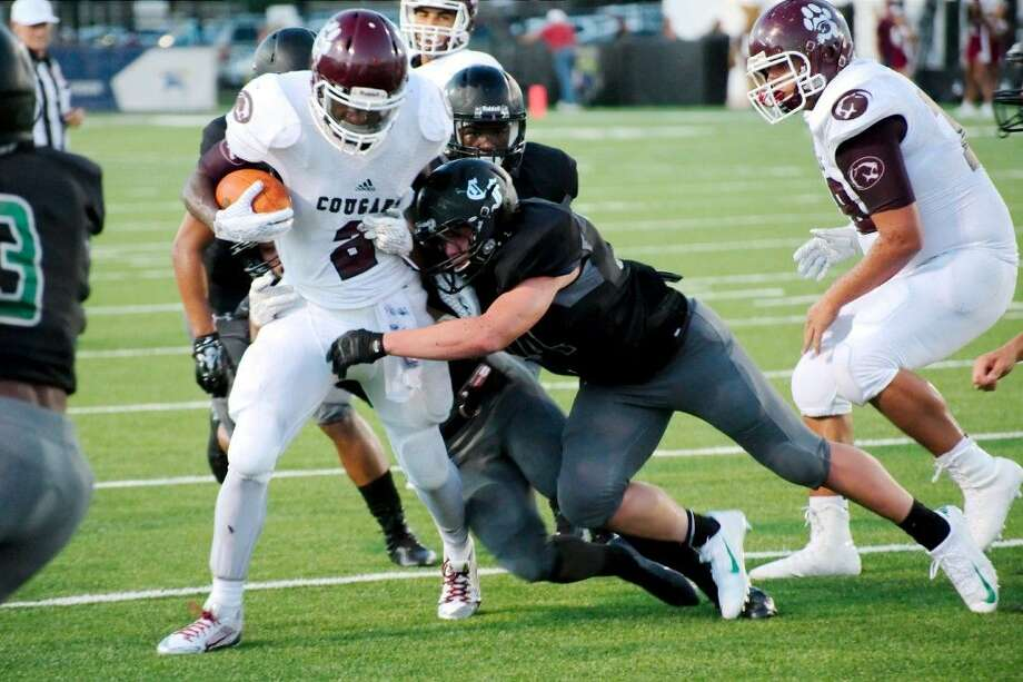 Kempner's Billy Reagins (2) was voted to the District 23-6A first team as a fullback. The Cougars improved to 4-6 this season. Photo: Kirk Sides