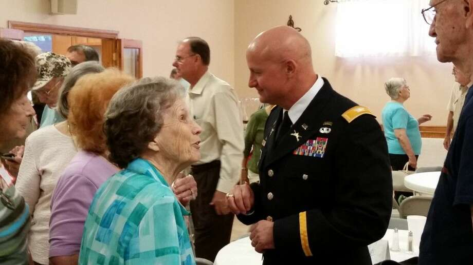 Newly promoted Army colonel Mike Mittag talks with family and friends at First United Methodist Church during a luncheon in Humble.