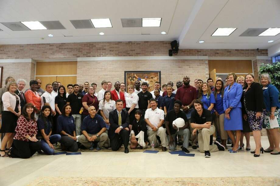 Representatives from nine community colleges and ExxonMobil gathered for a photo with recipients of the 2015 CCPI scholarship in the Nolan Ryan Center in Alvin following a luncheon for the recipients. Photo: Submitted
