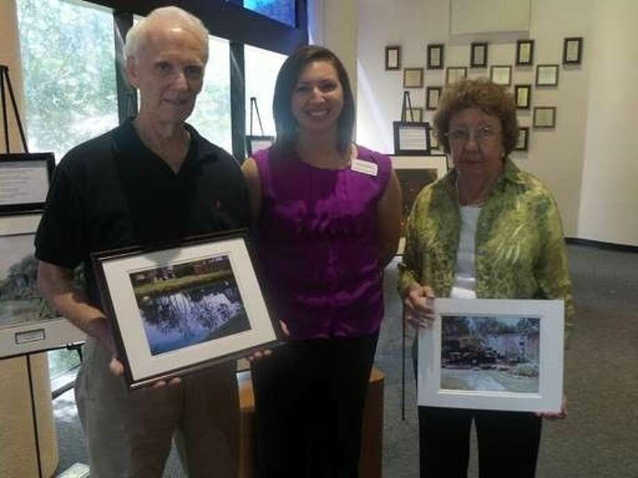 Alzheimer's Association patients Tony Hughes, left, and Ellen Box, right, pose with Marisa Ramón, a regional outreach coordinator with the Alzheimer's Association, and pose with their own photographs. Photo: Submitted