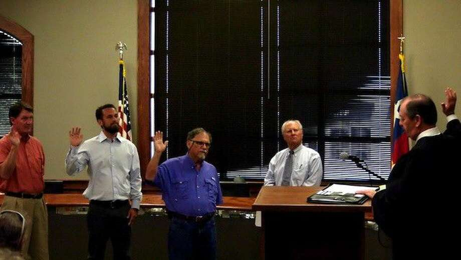 City of Liberty Municipal Judge Mike Little swears in returning council members David Arnold, at left, and Louie Potetz, center, along with their newly elected member, Paul Glazener, at the council's meeting on Tuesday, May 10, 2016. Photo: Casey Stinnett