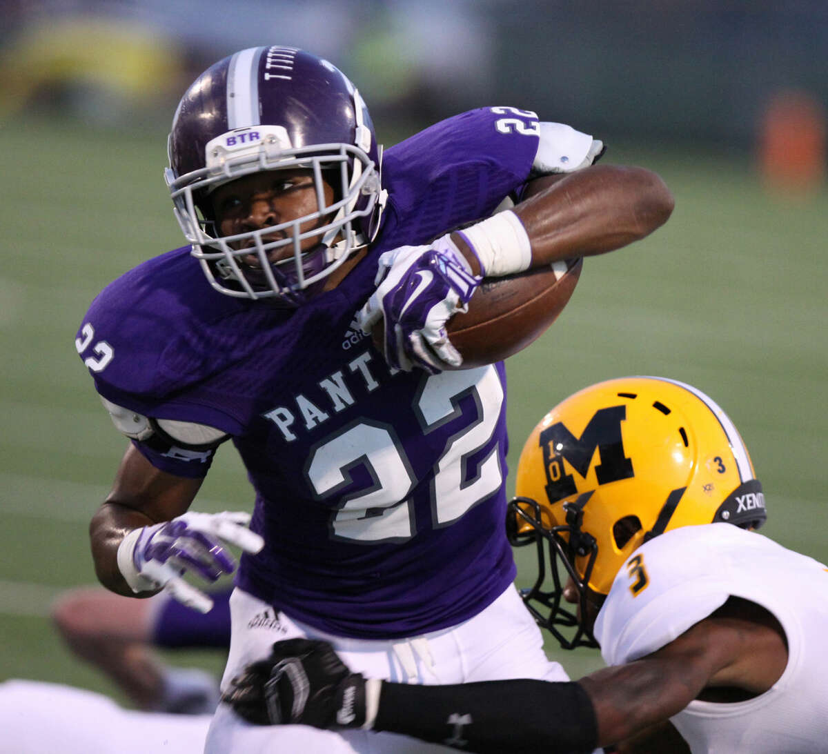 Ridge Point's Remus Butler runs against Marshall's Trevon Guillory during a District 23-5A game Sept. 25 at Hall Stadium in Missouri City. The Panthers won 13-0. To view or purchase this photo and others like it, go to HCNPics.com.