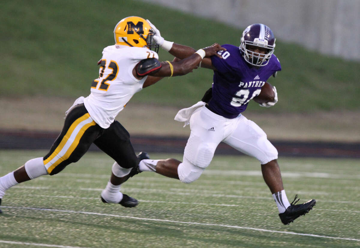 Ridge Point's KeShawn Ledet runs against Marshall's Dominick Dykes during their Sept. 25 game at Hall Stadium in Missouri City. To view or purchase this photo and others like it, go to HCNPics.com.