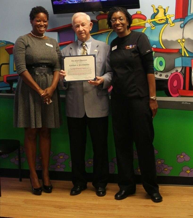 Mayor Tom Reid (center) presented a proclamation to Nightlight Pediatric Urgent Care co-founders Zawadi Bryant, MBA, chief operating officer (pictured left) and Dr. Anastasia L. Gentles, medical director (pictured right). Photo: Kristi Nix