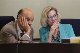 Dr. Michael Kirst, president of the state board of education, confers with Karen Stapf Walters, the board's executive director as they take public comments on a proposal to broaden the curriculum of California's history and social science classes during a meeting of the State Board of Education, Thursday, July 14, 2016, in Sacramento, Calif. One of the proposals California education officials are considering would require the inclusion of prominent gay people and LGBT rights milestones in history classes. (AP Photo/Rich Pedroncelli)