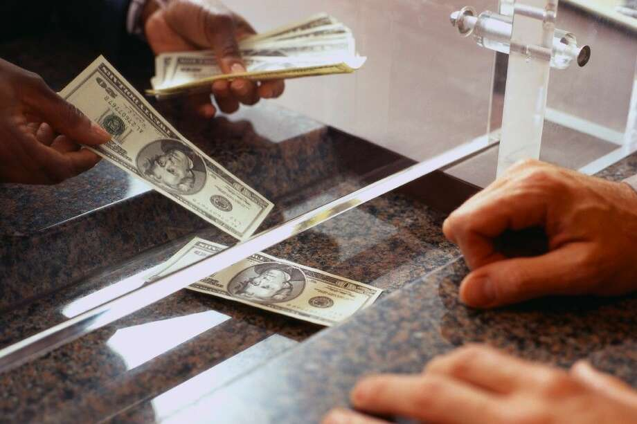 Bank customers have been depositing more money into their accounts, which is a sign of consumer confidence. This is good news for the area's businesses because historically banks see an increase of account withdraws after stock market declines, indicating a general fear of economic instability. Photo: © Duncan Smith/Corbis