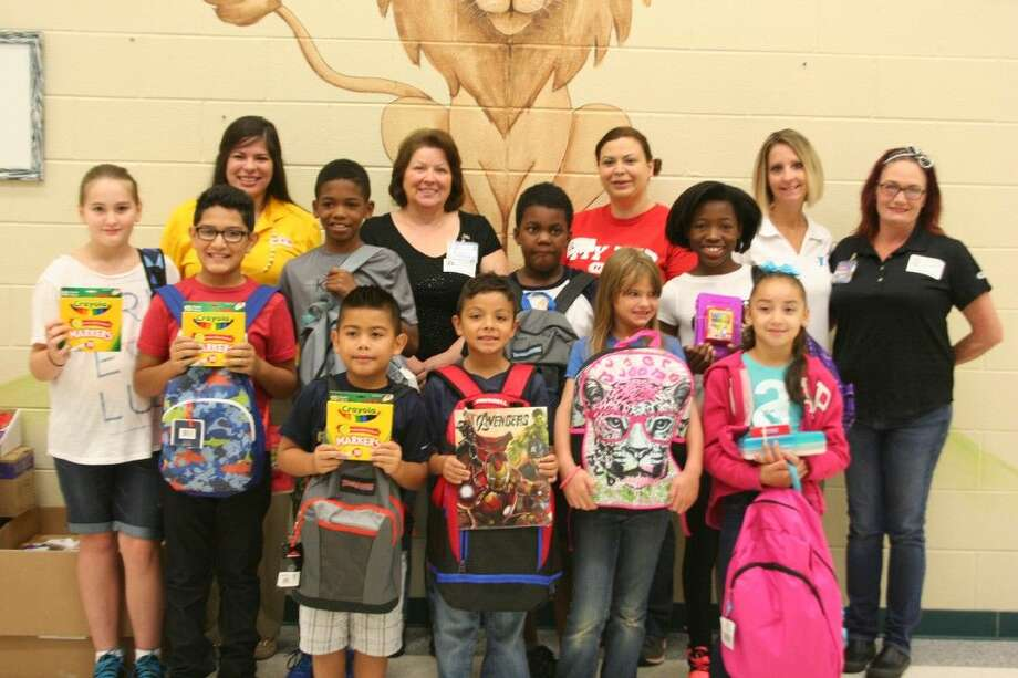 Park Lakes Elementary students show off the school supply donations presented them thanks to donations by Lake Houston Family YMCA members; the three H-E-B grocery store locations in Kingwood, Atascocita and Summerwood; Chase Bank and Lakeside United Methodist Church.