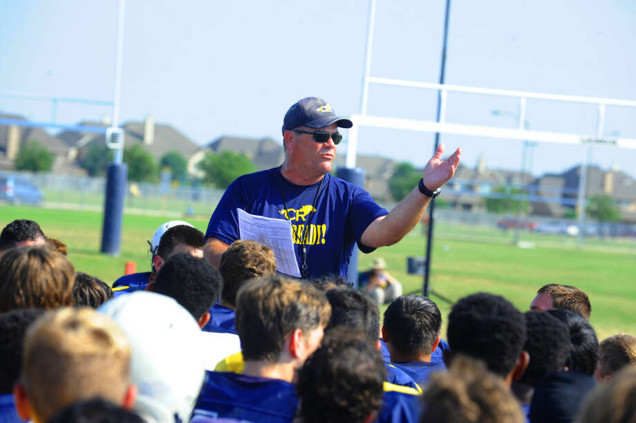Cypress Ranch Mustangs head coach Gene Johnson speaks to the team after a spring practice Thursday, May 12, 2016. The team has a number of key returning starters, like running back E.J. Thompson, and wide receivers R.J. Sneed II and Keric Wheatfall, that will put them in position to compete for another district title. Photo: Tony Gaines