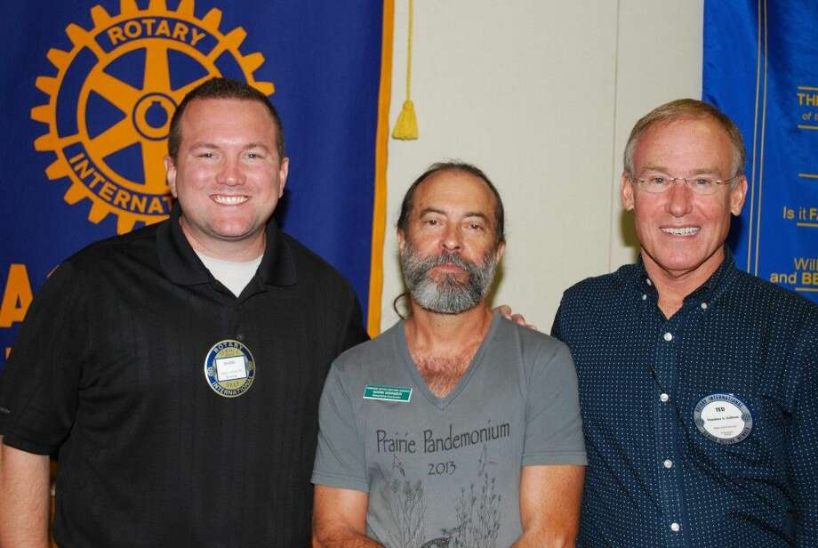 Pasadena Rotarians received an interesting Armand Bayou update from one of the Bayou's well-known Biologists, Mark Kramer shown here (C) with Rotarians Mark Anton (L) and Ted Sullivan (R).
