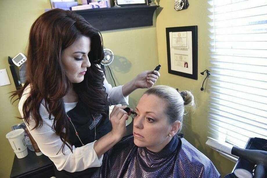 College training served as a career accelerator for San Jac Certified cosmetology graduate Roberta Garcia, shown applying makeup to client Amy Henley at the Helloo Beautiful Me Salon located in Humble.