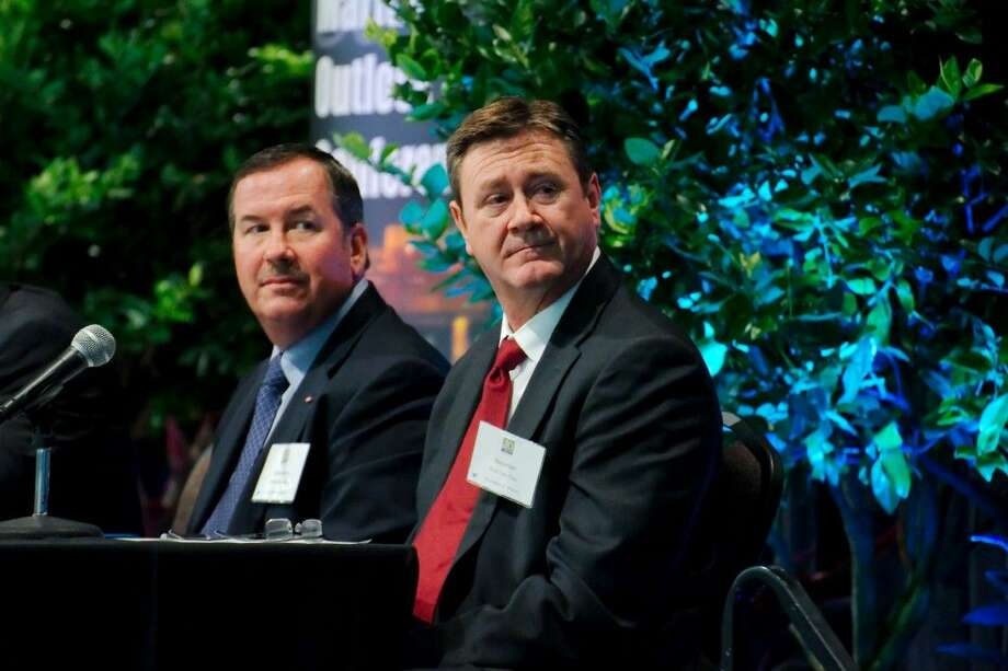 Dow Plant Manager Monty Heins and Shell Deer Park General Manager Barry Klein sit on a petrochemical and refining panel Texas during the Petrochemical Maritime Outlook Conference last Thursday.