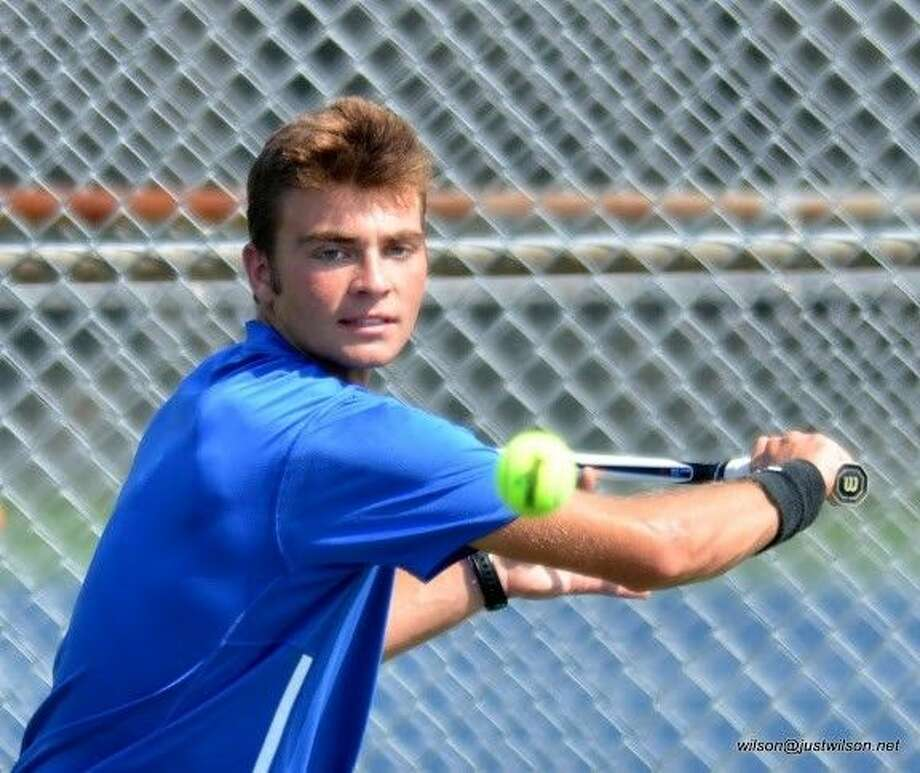 Nick Purdum prepares to hit a backhand during Friendswood High School's varsity team tennis match against Humble Kingwood. Photo: WILSON BARBEE