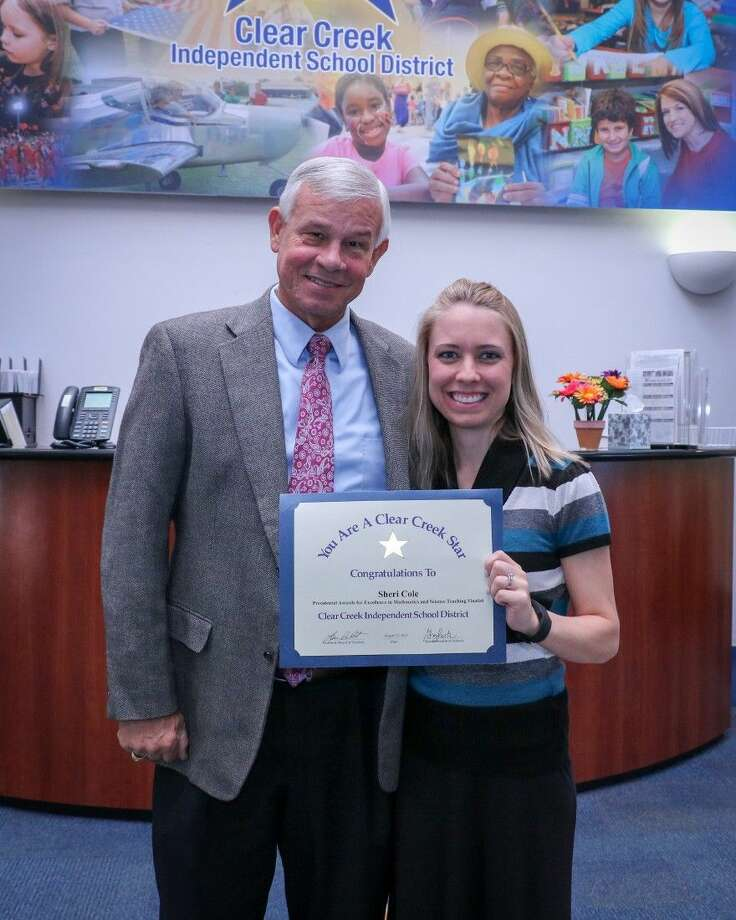 Pictured, left to right, are Seabrook Intermediate Principal David Williams congratulates Teacher Sheri Cole, 7th grade science on her selection as a finalist for the 2015 Presidential Awards for Excellence in Mathematics and Science Teaching.