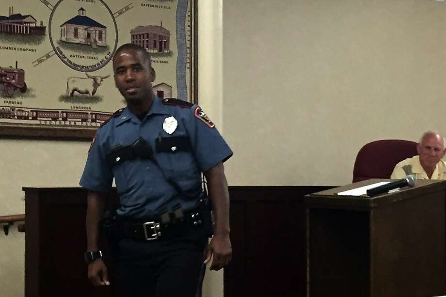"Dion Hinton has joined the Dayton Police Department. He was welcomed Monday night, Aug. 31, by the Dayton City Council. Hinton told council members he looks forward to getting to know them ""hopefully, in a good way."" Photo: Casey Stinnett"