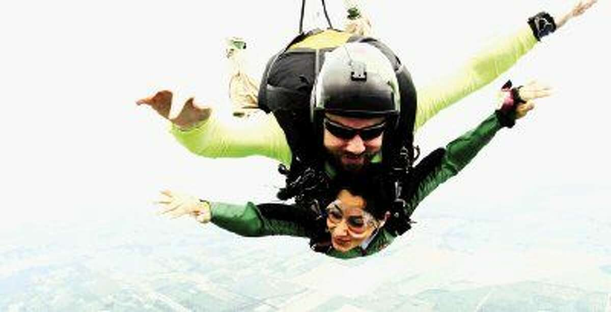 Neha Abassi skydives at Jump! Shout! fundraiser in tandem with instructor Kieran Maguire for an unforgettable plunge to benefit CCRF.