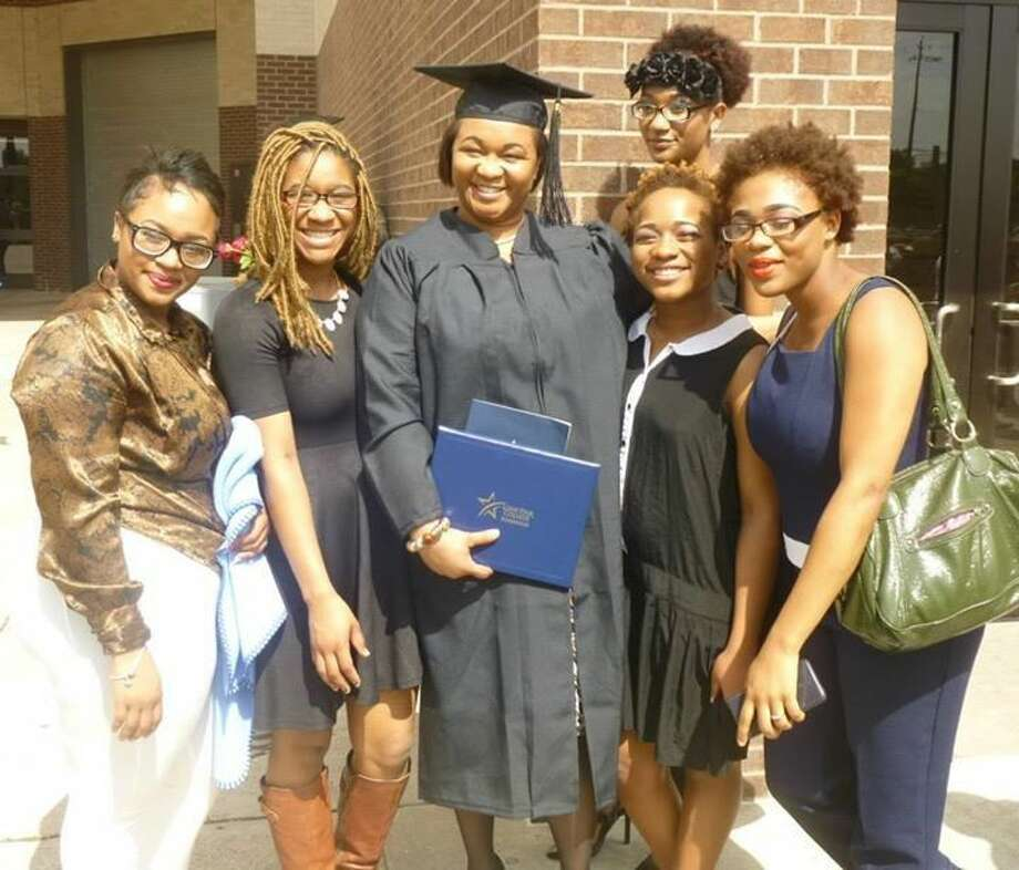 Nureka Chapman-Henderson with her five daughters on graduation day.
