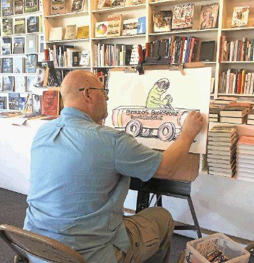 On March 26, Bill Megenhardt drew artwork for children at the Brazos Bookstore story time.