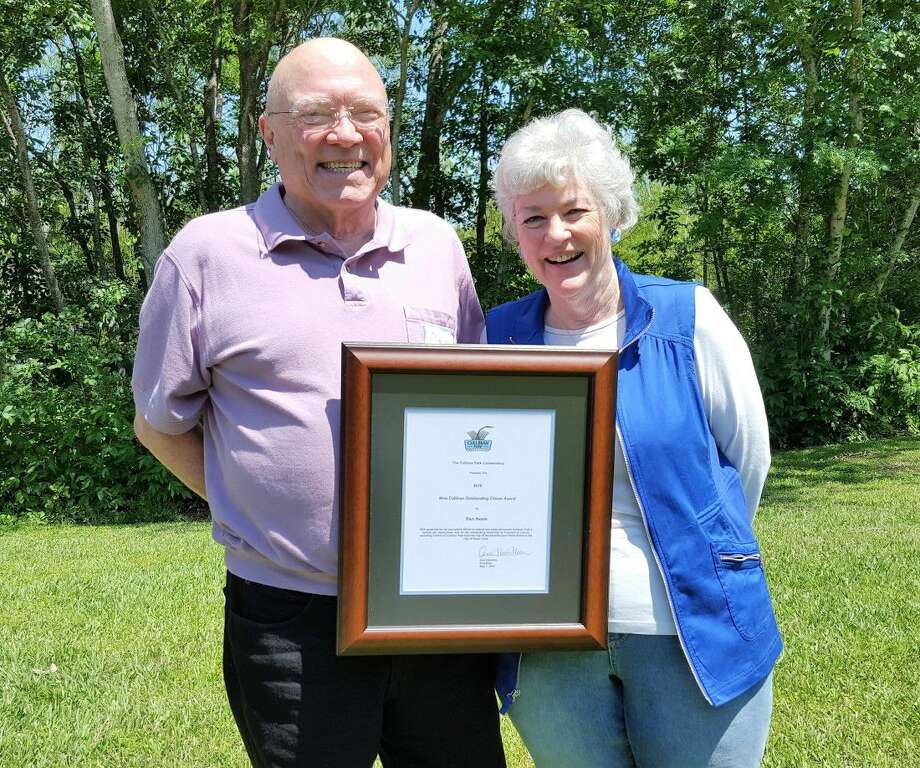 Past president Dan Neale accepts the 2016 Nina Cullinan Outstanding Citizen Award for his contributions as former CPC President Award from current President Ann Hamilton.