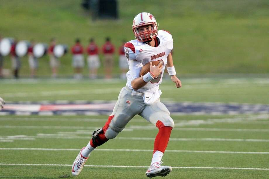 Memorial quarterback Colton Taylor turns his way up the field as the Stratford defense closes in during the Mustangs' season opener last Thursday night at Tully Stadium.