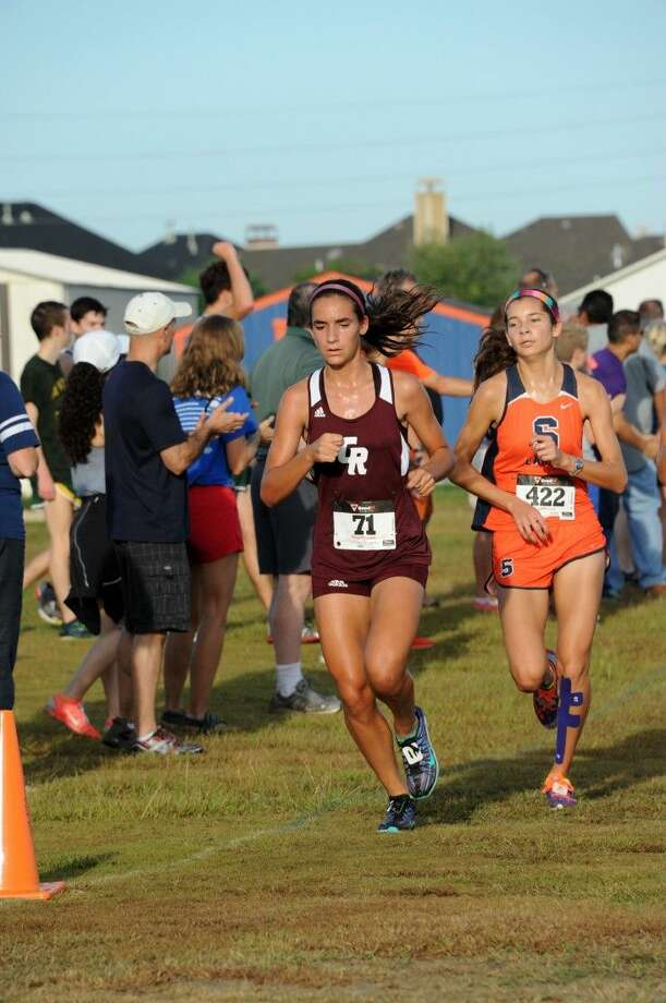 Cinco Ranch's Kaitlyn Garza and Seven Lakes' Camilla Broman competed in the 2014 Seven Lakes Showcase. The Lady Cougars won the team championship, with the Lady Spartans second in a close race. Photo: Craig Moseley