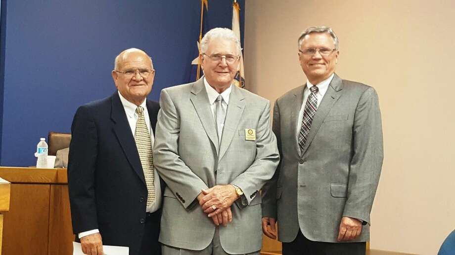 Mayor Merle Aaron (left,) councilman Allan Steagall (middle,) and councilman Norman Funderburk (right) pose during the Humble City Council Swearing-in and Reception at the Humble City Council Chamber Thursday, May 12.