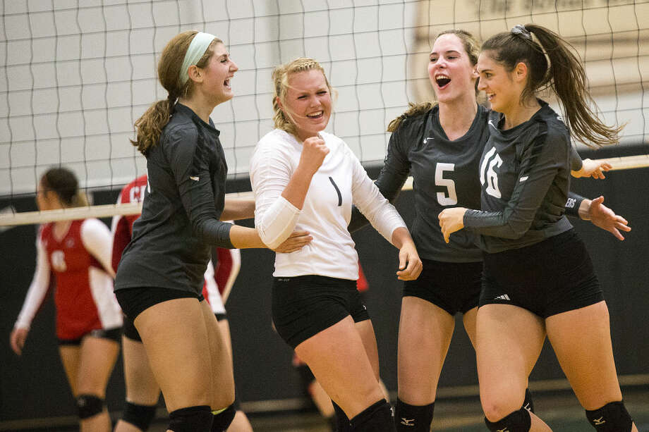 The Lady Panthers celebrate a point during Kingwood Park's 3-0 sweep against Crosby on Sep. 1, 2015, at Kingwood Park High School. Photo: ANDREW BUCKLEY