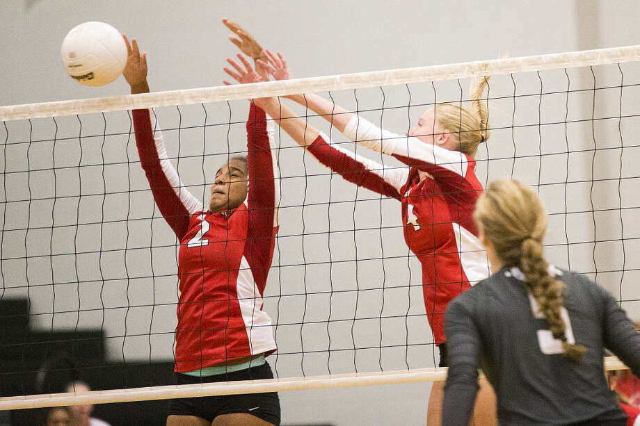 Crosby's Sloan Casey (2) blocks a spike with Alison Muldrow (4) during Kingwood Park's 3-0 sweep against Crosby on Sep. 1, 2015, at Kingwood Park High School. Photo: ANDREW BUCKLEY