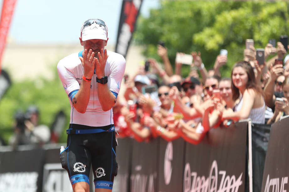 Patrick Lange, of Germany, reacts as he approaches the finish line, placing first in the Memorial Hermann IRONMAN North American Championship on Saturday, May 14, 2016, in The Woodlands, Texas. To view more photos from the event, go to HCNPics.com. Photo: Michael Minasi