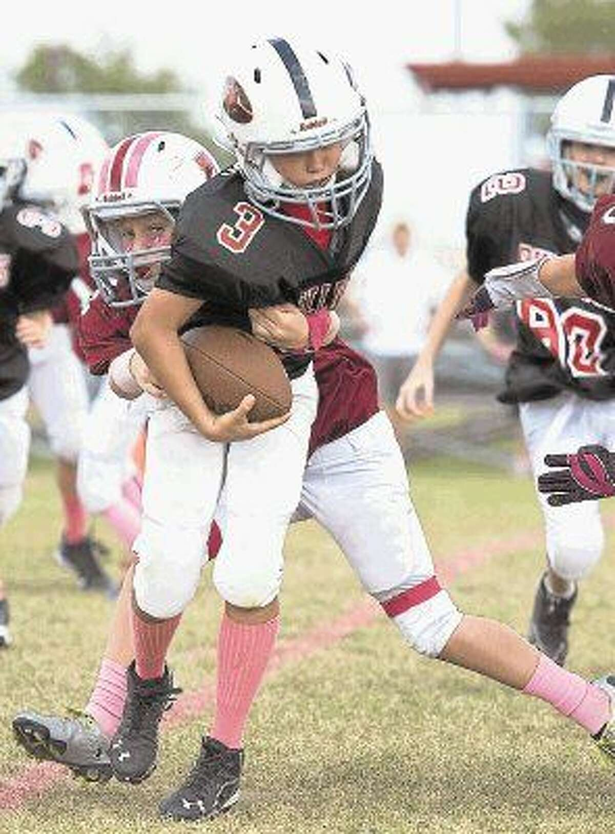 For the past couple of seasons, the Southwest Football League youth football players have wore pink accessories for its annual Pink One: Tackle Cancer event to raise awareness for breast cancer and those the disease affects. The SFL is one of many teams in the Examiner area that will remember breast cancer victims over the next month by wearing pink on the field of play.