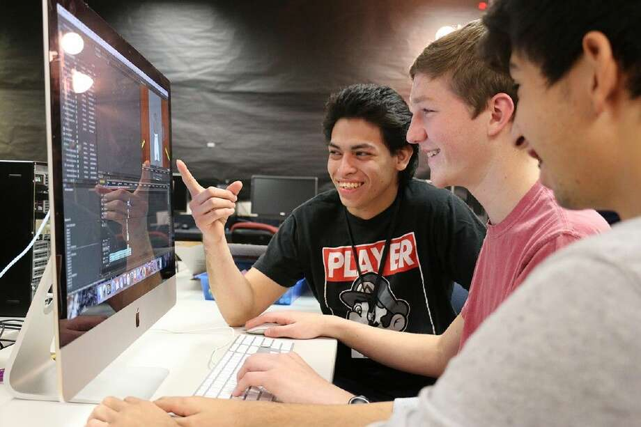 """Mike Benavides, Alex Clinebell, Ronald Rosales tweak the final render of """"Parched"""" in Adobe Premiere."""