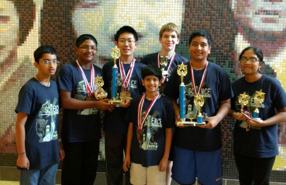 Spillane Middle School's math and science team celebrates its impressive performance at the TMSCA State Championship meet at UT—San Antonio. Pictured, from left, are Archit Junnarkar, Rahul Shanmugham, Steven Cheng, Ashay Swadi, Tristan Wiesepape, Govind Chada and Sritha Cheemerla. Not pictured are Angela Zhong and Ruhi Mukherjee.
