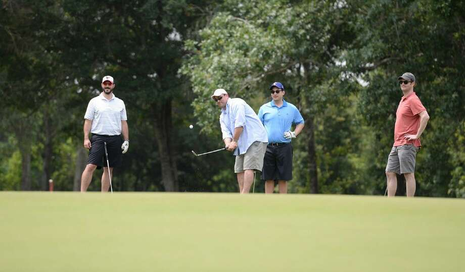 Golfers aim for the green during the 28th annual BF Adam Golf Classic on May 12 at BlackHorse Golf Club. The event is expected to raise approximately 145,000 for student scholarships through the Cy-Fair Educational Foundation.