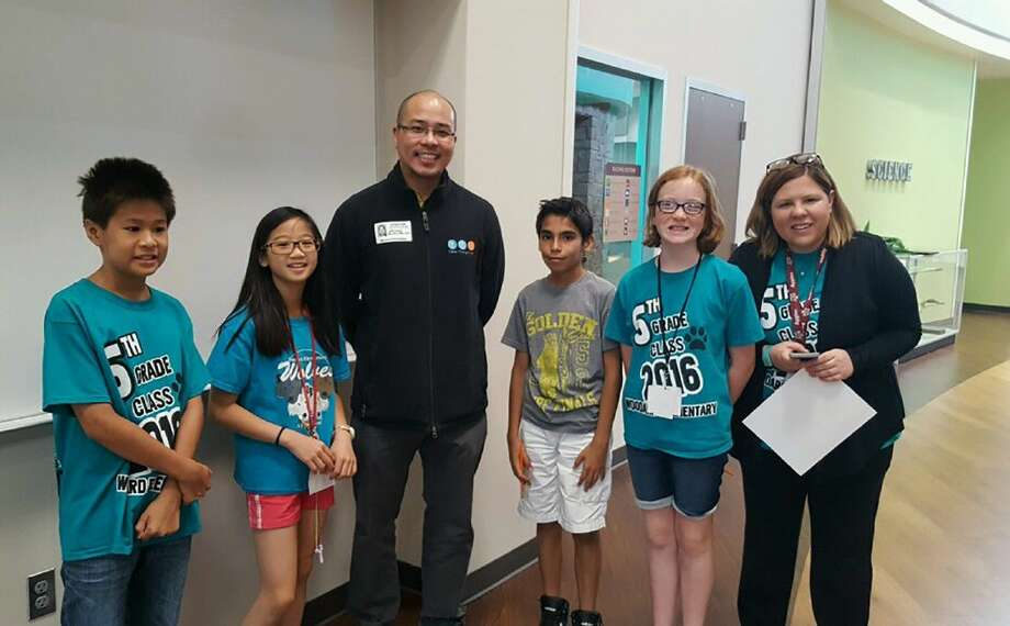 Jeff Liwag with Think Through Math commends Woodard Elementary School for it success in the program. Pictured, from left, are Eric Xie, Emily Nguyen, Jeff Liwag, Isaac Perez, Lucy Adams and Woodard fifth-grade teacher Jenny Lisk.