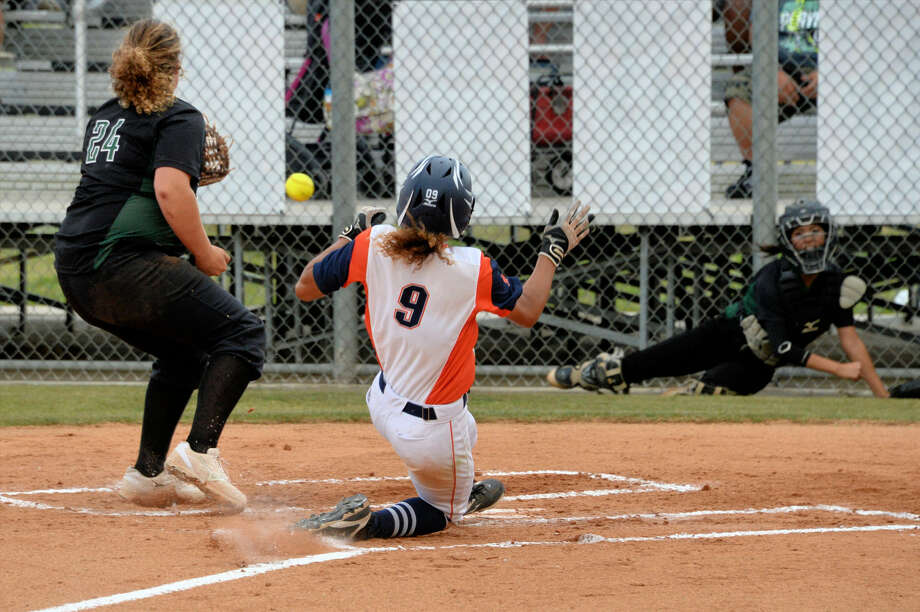 Seven Lakes' Makayla Engelstad beats the throw to the plate from Mayde Creek catcher Allyson Gonzalez during game one of their 6A Region III Quarterfinal series May 12 at SLHS. Visit HCNPics.com for more photos. Photo: Craig Moseley