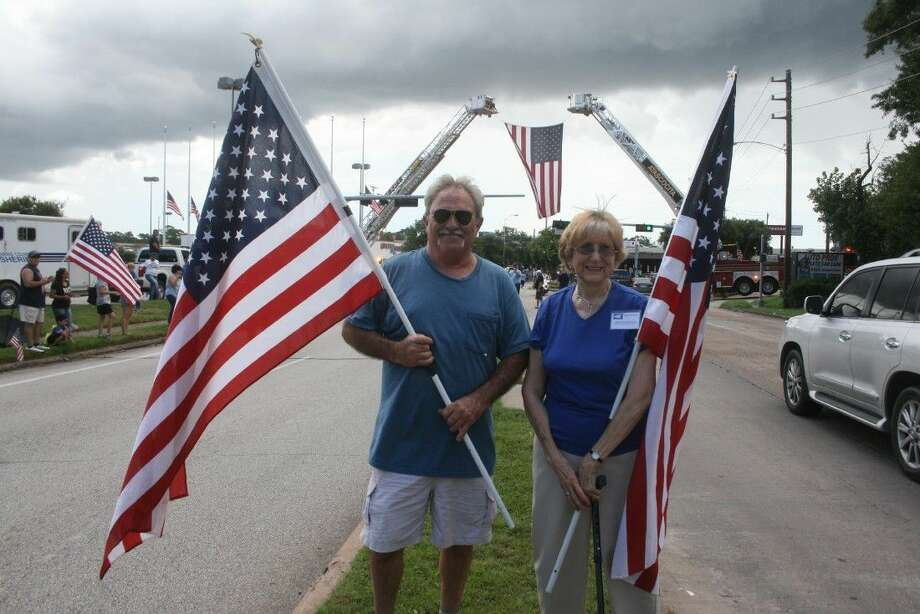 Bert McCormick and his senior citizen neighbor, Vivian Walkins, loaded up his pickup with 60 flags and drove to Spring Branch to participate in the community support for Deputy Darren Goforth who was gunned down last week at a gas station in Cypress. McCormick said he was glad he could help in some small way.