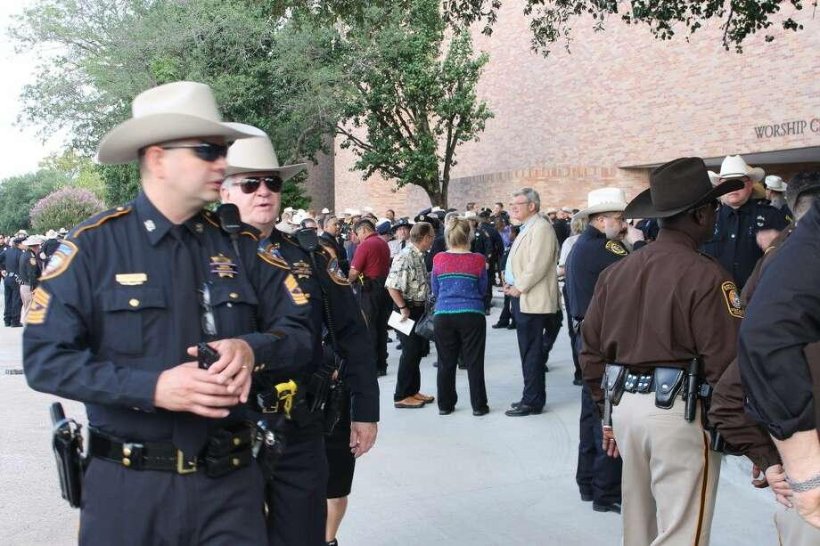 Officers making their way to the church. Photo: Taelor Smith