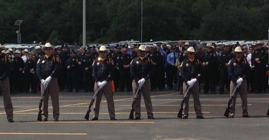 Officers present gun salute. Photo: Taelor Smith