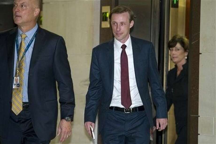 Former Hillary Clinton aide, during her tenure as Secretary of State, Jake Sullivan, center, arrives to be interviewed before a House panel on the Benghazi investigation on Capitol Hill in Washington, Friday. Sullivan, a former policy director and deputy chief of staff at the State Department, will be questioned Friday in what is expected to be a daylong session. Photo: Cliff Owen