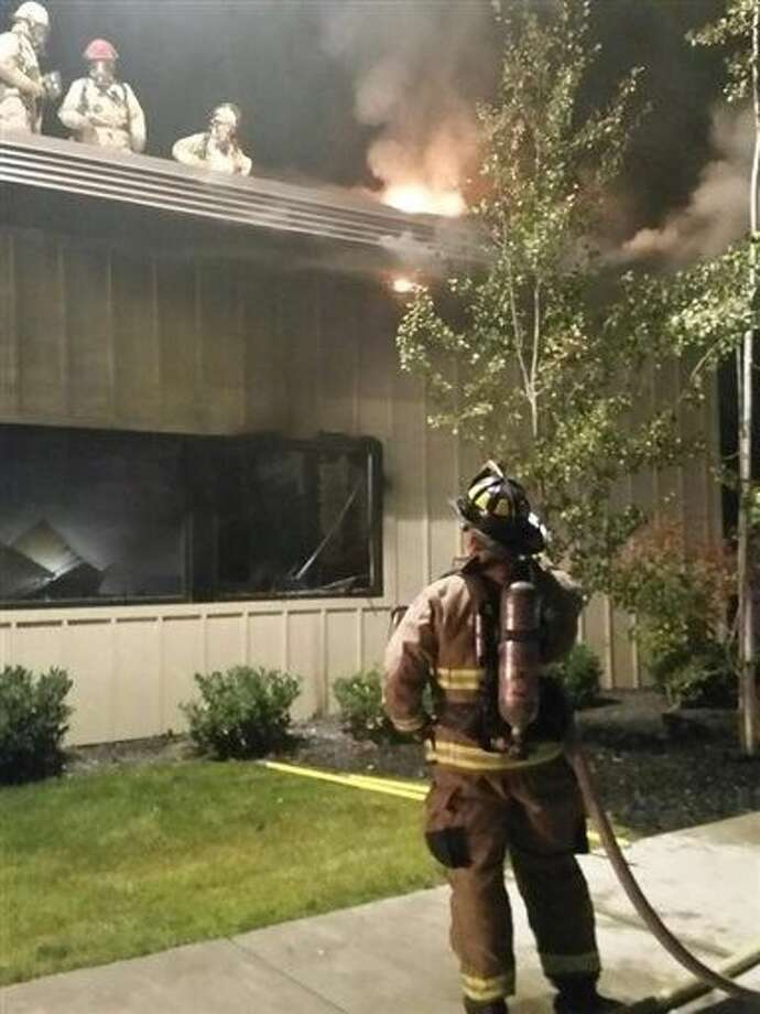 Firefighters try to put out a fire at a Planned Parenthood clinic in Pullman, Wash., Friday. The pre-dawn fire heavily damaged the clinic in the college town and a regional terrorism task force is working to determine whether it was arson. Photo: TEL