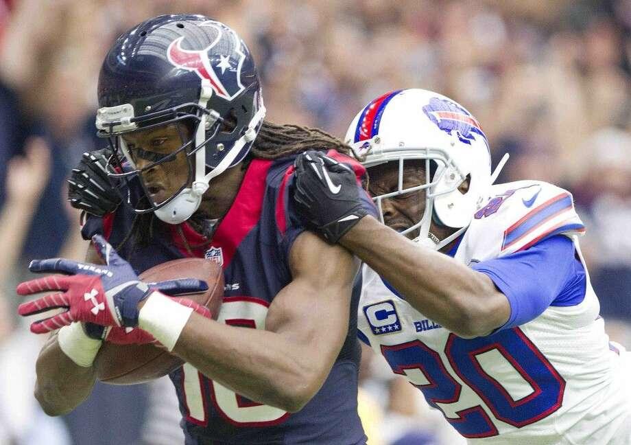 Houston Texans wide receiver DeAndre Hopkins scores a touchdown as Buffalo Bills cornerback Corey Graham defends. The Texans won 23-17. Photo: Jason Fochtman