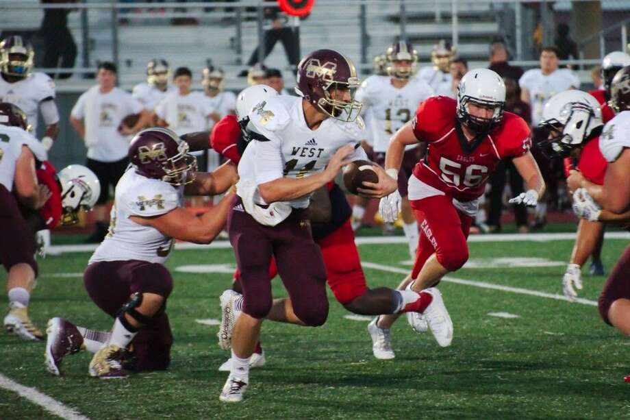 Magnolia West's Tyler Ferre (11) looks for running room against Dawson Friday. Photo: KIRK SIDES