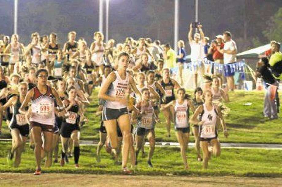 Runners from the annual Friday Night Lights cross country meet at Bear Branch Park in The Woodlands.