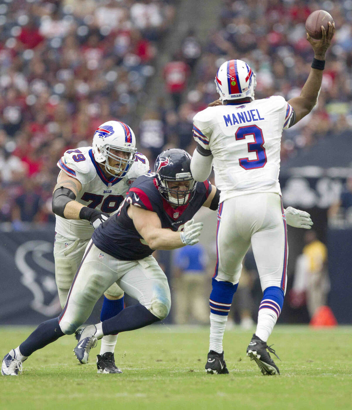 Houston Texans defensive end J.J. Watt pressures Buffalo Bills quarterback EJ Manuel during the first half of an NFL football game Sunday. The Houston Texans defeated the Buffalo Bills 23-17.