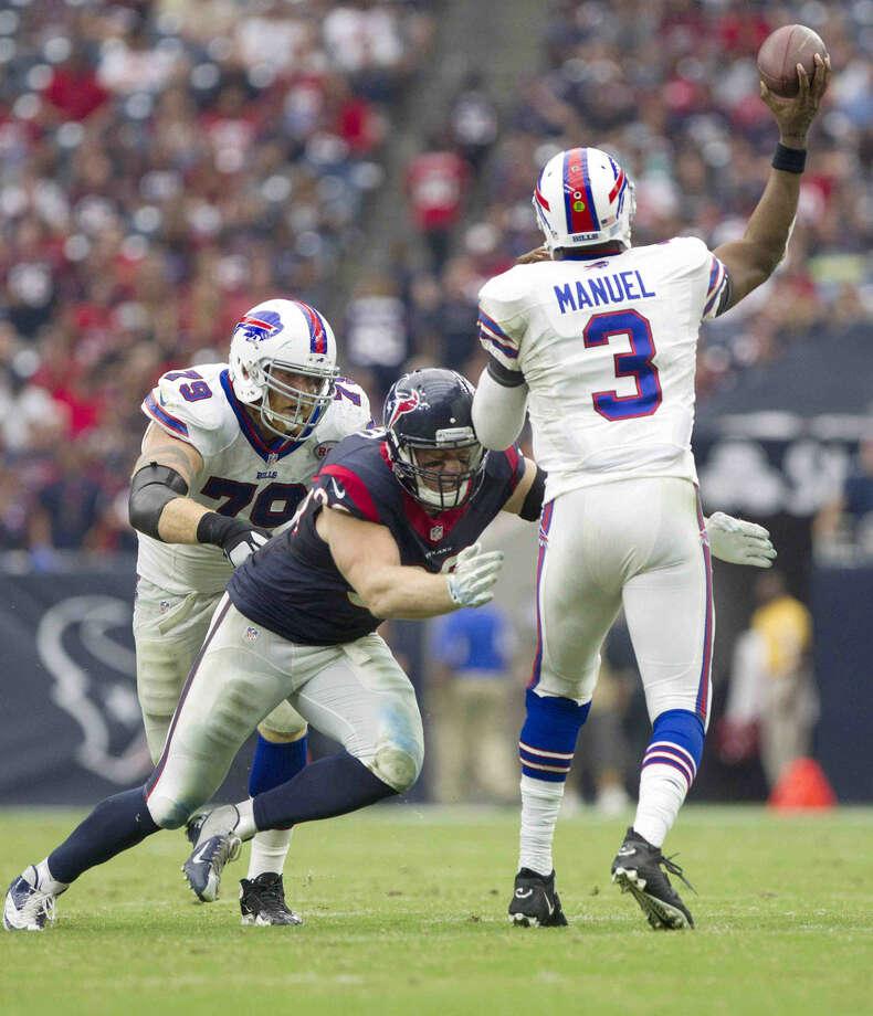 Houston Texans defensive end J.J. Watt pressures Buffalo Bills quarterback EJ Manuel during the first half of an NFL football game Sunday. The Houston Texans defeated the Buffalo Bills 23-17. Photo: Jason Fochtman