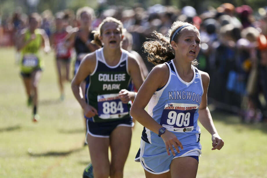 Erin Gallagher (front) finished second with a time of 19:03.71 and teammate Olivia Thompson ran third to lead Kingwood to the team championship at the Seven Lakes Showcase, Sept. 5 at Seven Lakes High School. Photo: Michael Minasi